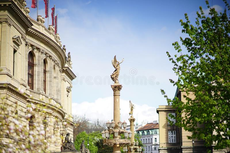 A goddess sculpture in front of the music hall stock images
