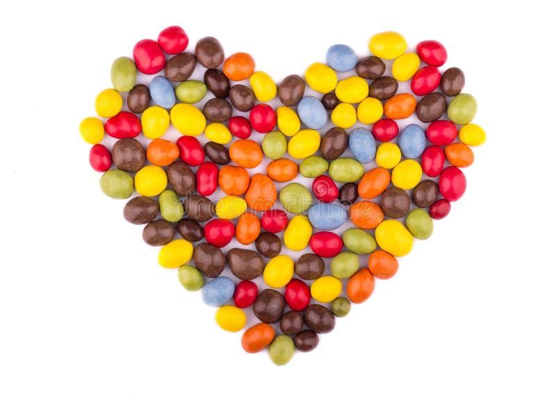 Godisen färgade glasyr i formen av hjärta som ett symbol av förälskelse fotografering för bildbyråer