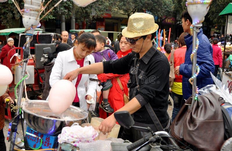 godisporslinbomull som gör manpengzhou arkivfoton