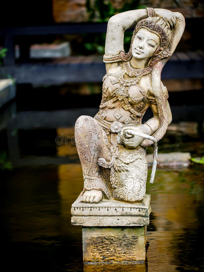 Beautiful Balinese Style House In Hawaii: Godress Sculpture In A Bali Style Garden Stock Image