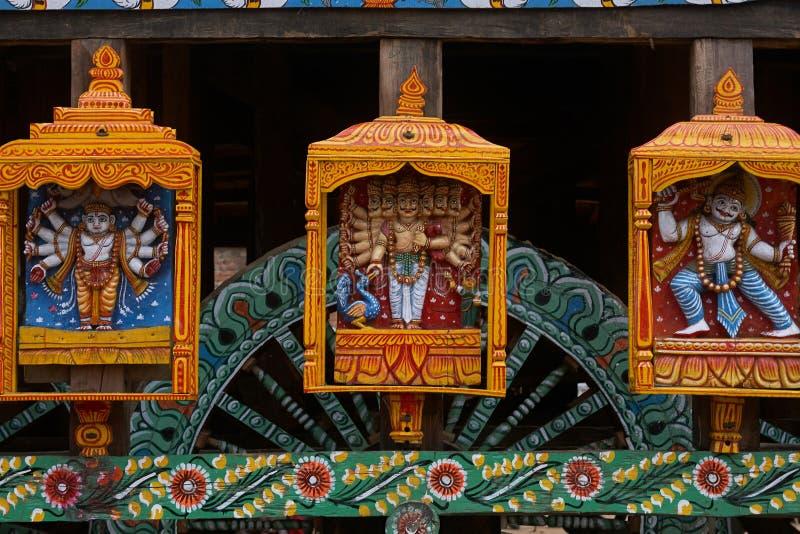 2007 Gods statues at wheel of chariot rath yatra of jagannath ; Puri ; Orissa ; India. 24-jun-2007 Gods statues at wheel of chariot rath yatra of jagannath stock photography