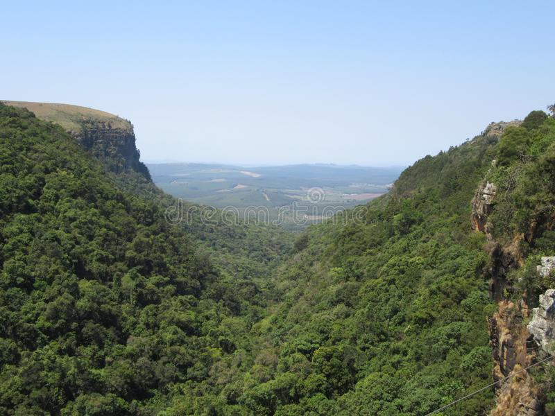 Gods Window. Lookout point from Graskop Gorge in the distance we have Gods Window to the Lowveld SouthAfrica royalty free stock images