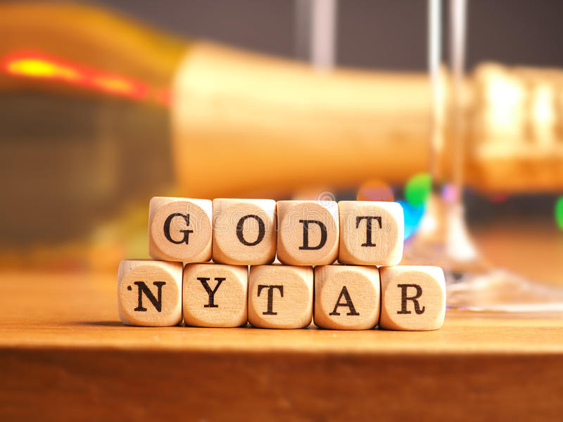 Godt Nytar, Happy New Year. Small wooden dices with the Danish words Godt Nytar, Happy New Year background royalty free stock images