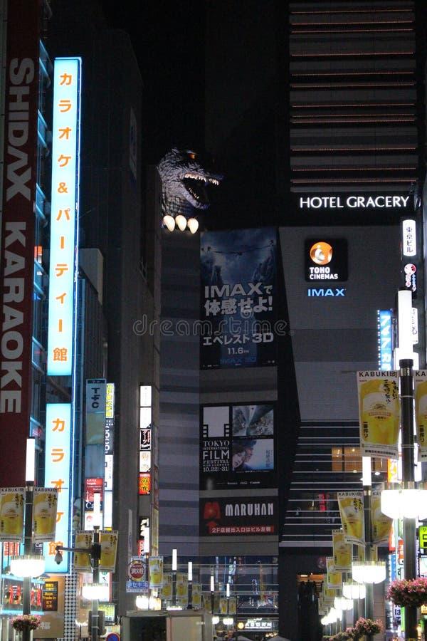 Godzilla on the roof. Full scale Godzilla mounted on Toho Cinema Building in Shinjuku stock photos