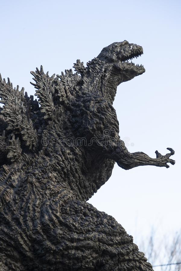 Godzilla statue in Hibiya. January 21, 2019, Tokyo, Japan - A Godzilla statue is seen in front of Hibiya Chanter shopping mall in Yurakucho district royalty free stock image