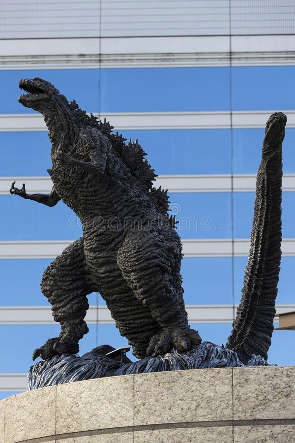 Godzilla statue in Hibiya. January 21, 2019, Tokyo, Japan - A Godzilla statue is seen in front of Hibiya Chanter shopping mall in Yurakucho district stock photography