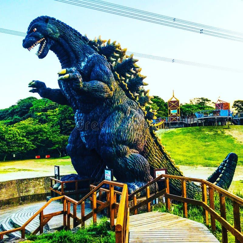 Godzilla statue. At Kurihama flower park in stock photos