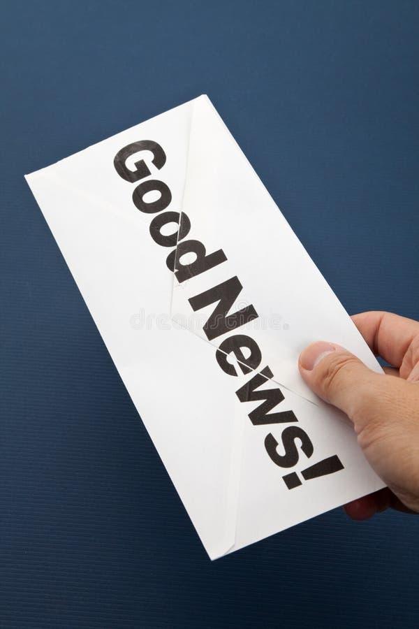 Goed Nieuws en envelop stock foto