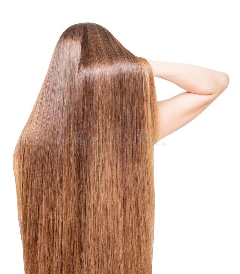 Goed-verzorgd, glanzend, lang haar dat terug meisje geïsoleerd stroomt royalty-vrije stock afbeelding