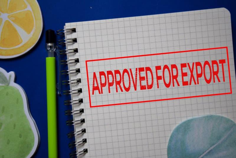 Goedgekeurd voor de Uitvoer schrijf op een boek dat op blauwe achtergrond wordt geïsoleerd stock fotografie
