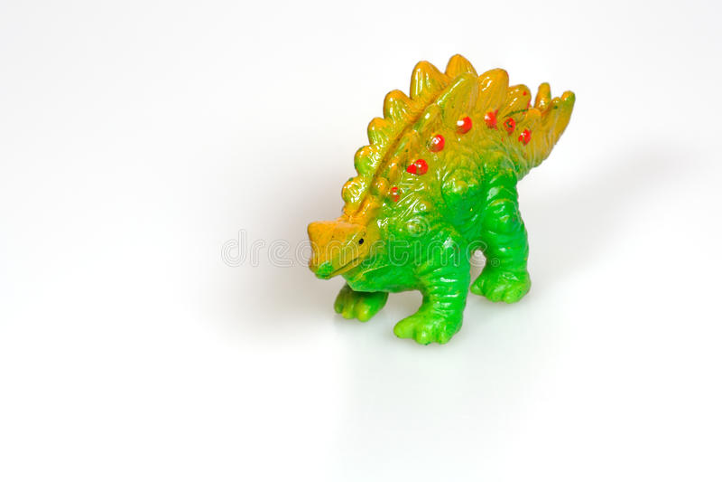 Goedkoop plastic dinosaurusstuk speelgoed stock afbeelding