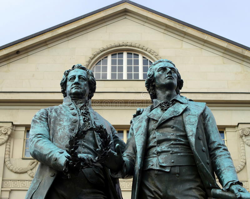 Goethe and Schiller. Statue of Statue of Johann Wolfgang von Goethe and Friedrich Schiller in Weimar. The city of Weimar in the federal state of Thuringia royalty free stock photo