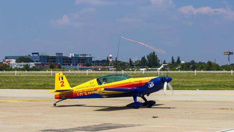Goger Atilla (Tail/Photoship) with YR-EWA. Goger Atilla (Hawks of Romania) with YR-EWA after aerobatics at Bucharest International Air Show 2013 stock images