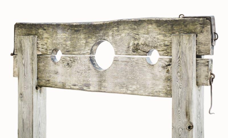 Gogna medievale di legno su bianco fotografie stock libere da diritti