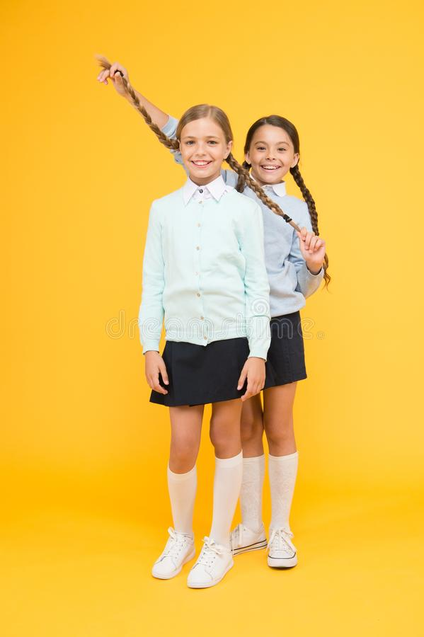 Going crazy. happy girls in school uniform. kid fashion. Friendship and sisterhood. education concept. back to school. Knowledge day. childhood happiness stock photo