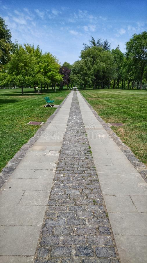 Going forward. Straight path in La Ciudadela park royalty free stock image