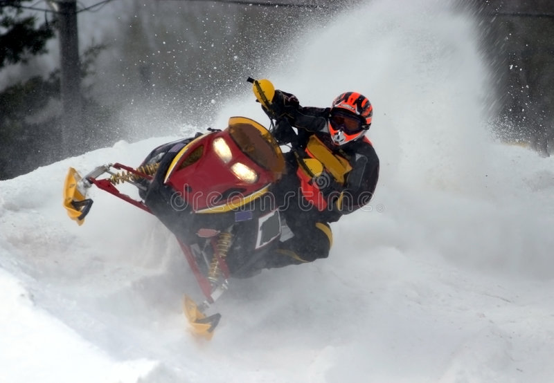 Going full tilt. Taken at Kirkland Lake snowcross. I was right on the track. It was dangerous as one guy found out. A snowmobile hit him in the chest and he died stock photos