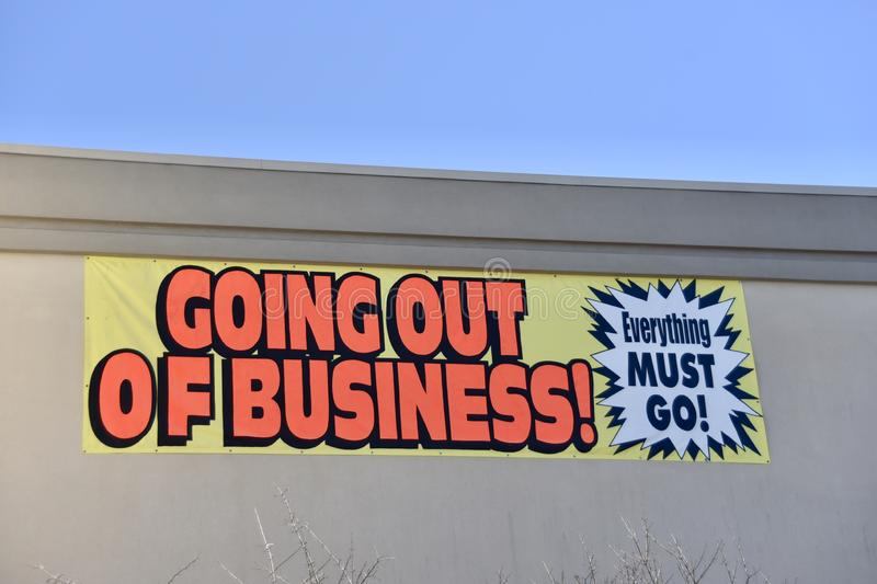 Going out of Business Sale. A retail store, outlet or commercial goods chain is a having a going out of business product and asset liquidation sale royalty free stock photography