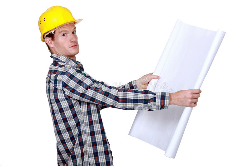 Going over construction plans royalty free stock image