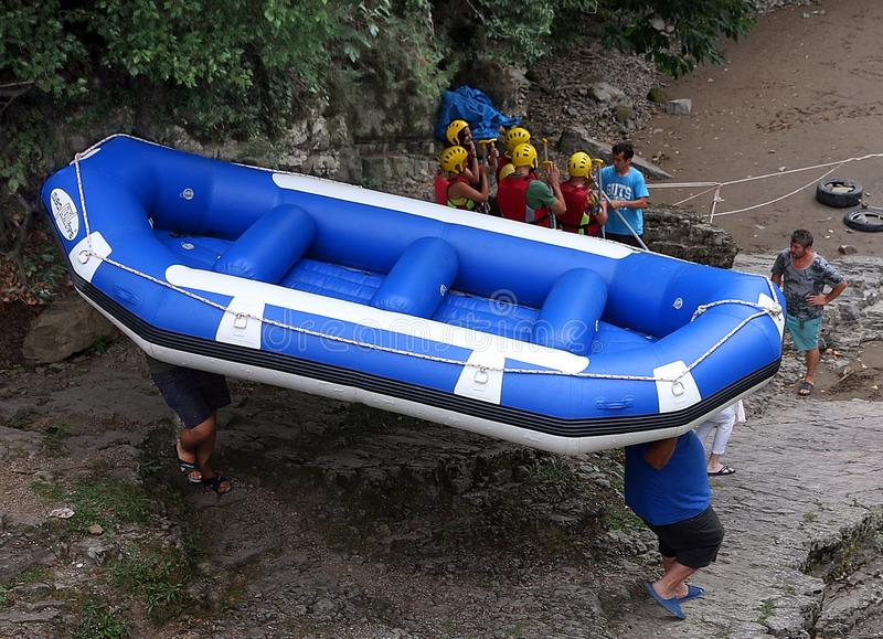 Going Rafting In Georgia. Rafting is a popular recreational  outdoor sport  which use an inflatable  boat and paddles. A group of tourists stock image