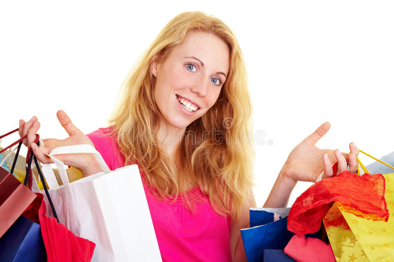 Going shopping. Happy woman with a lot of colorful shopping bags stock photos
