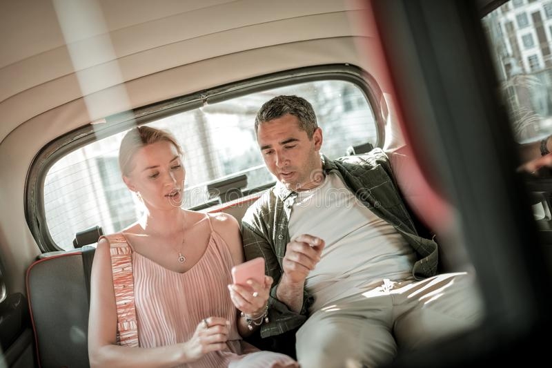 Couple looking at their destination point on the smartphone. royalty free stock photo