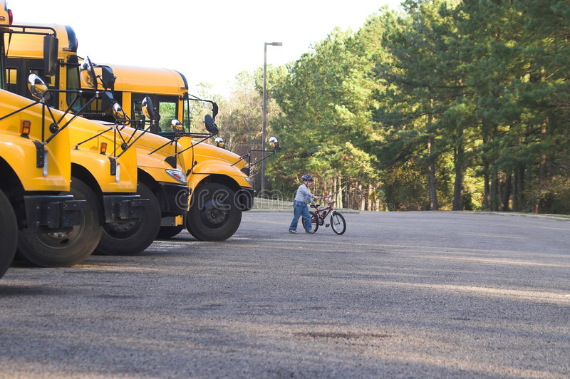 Going to School. A young boy with his bike on the way to school royalty free stock photos