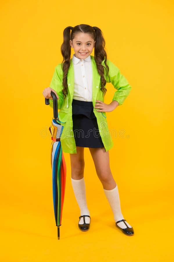 Going to school. Water resistant clothes. Protected concept. Rainproof clothes. Autumn accessory. Autumn weather royalty free stock image