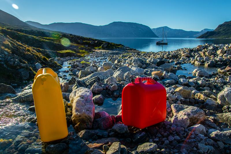 Fresh water. Filling water from spring in Greenland stock photo