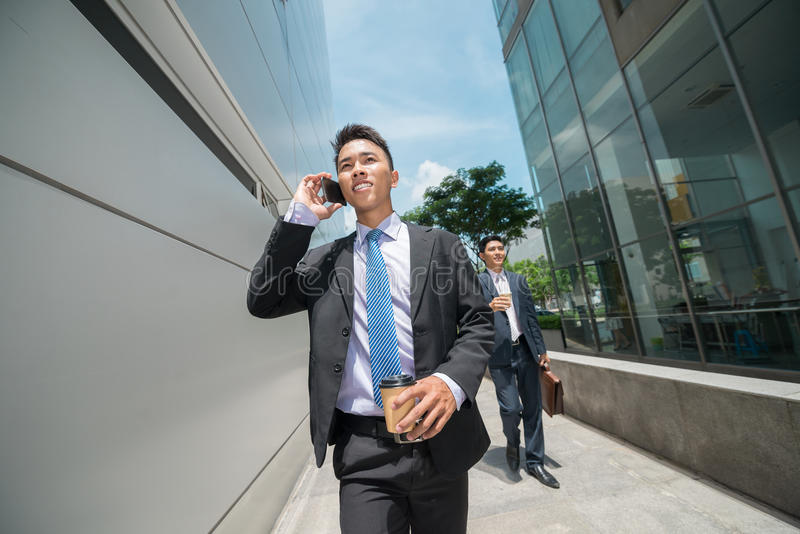 Going to work. Young businessmen going to the work in the morning stock photography