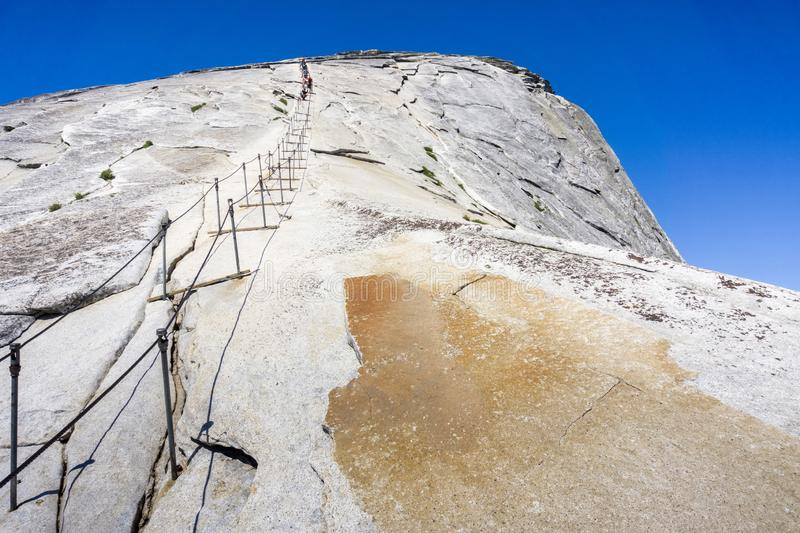 Going up on the Half Dome cables on a sunny summer day, Yosemite National Park, California royalty free stock photography
