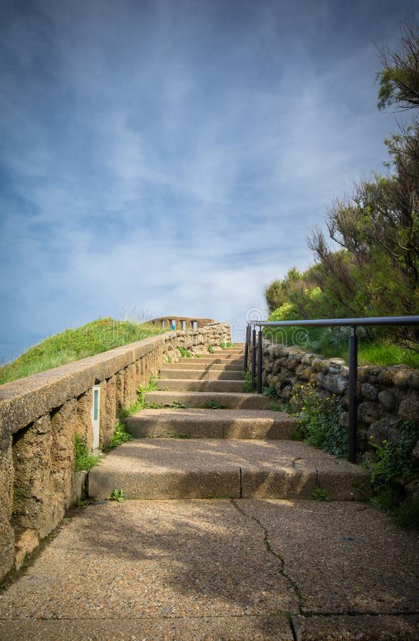 Going upstairs with copy space in scenic beautiful coastal park in blue sky, biarritz, basque country, france royalty free stock photo