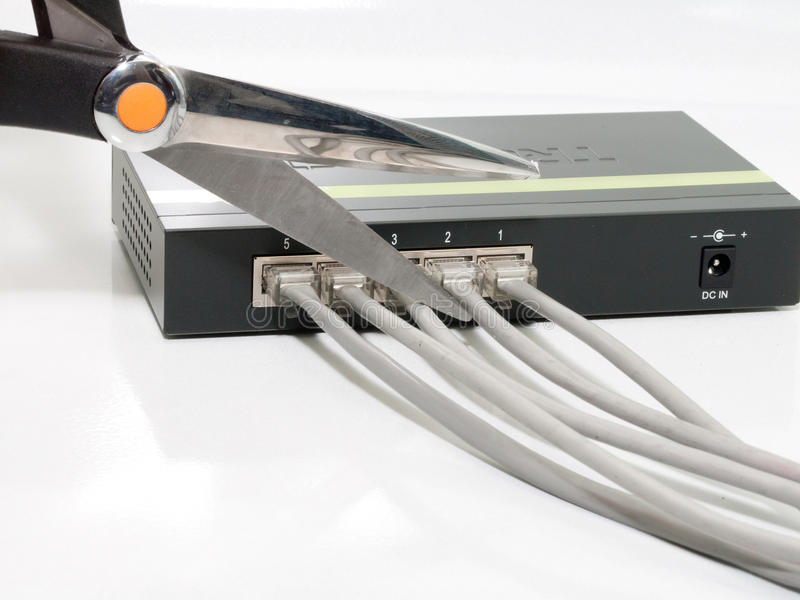 Going wireless, cutting connections. 5 numbered ports on a gigabit ethernet switch fully cabled, being cut off by a pair of scissors. no power stock photo