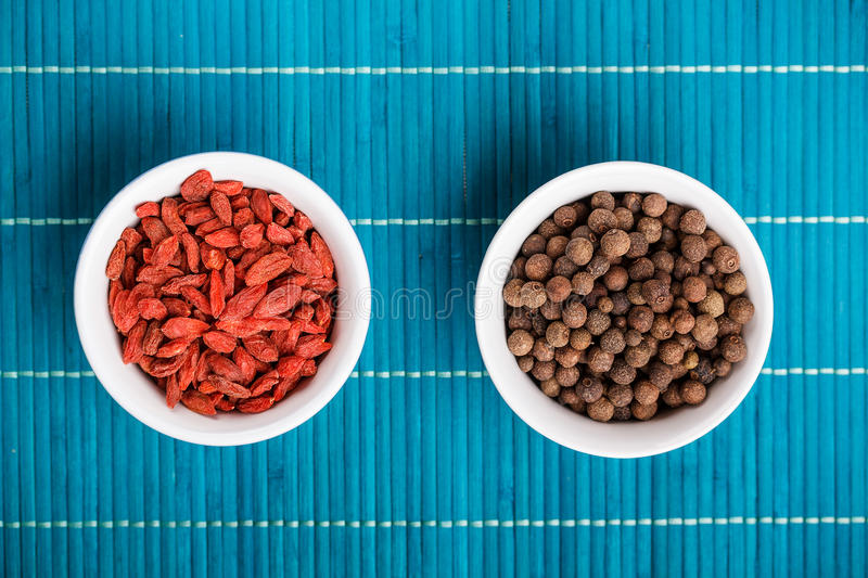 Goji berries and allspice royalty free stock photos