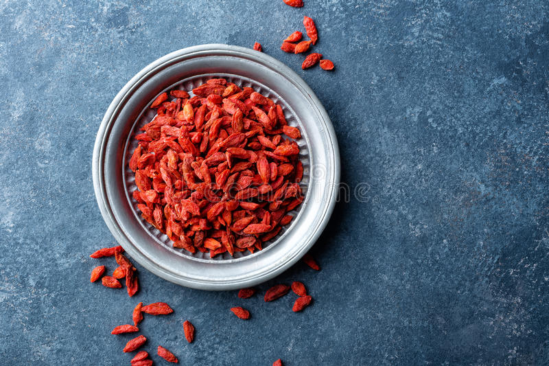 Goji berries. On dark background, top view, copy space stock photography