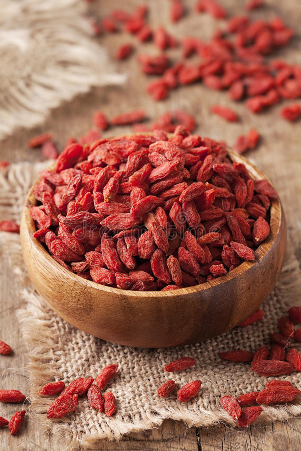 Goji berries. In a wooden bowl royalty free stock photo