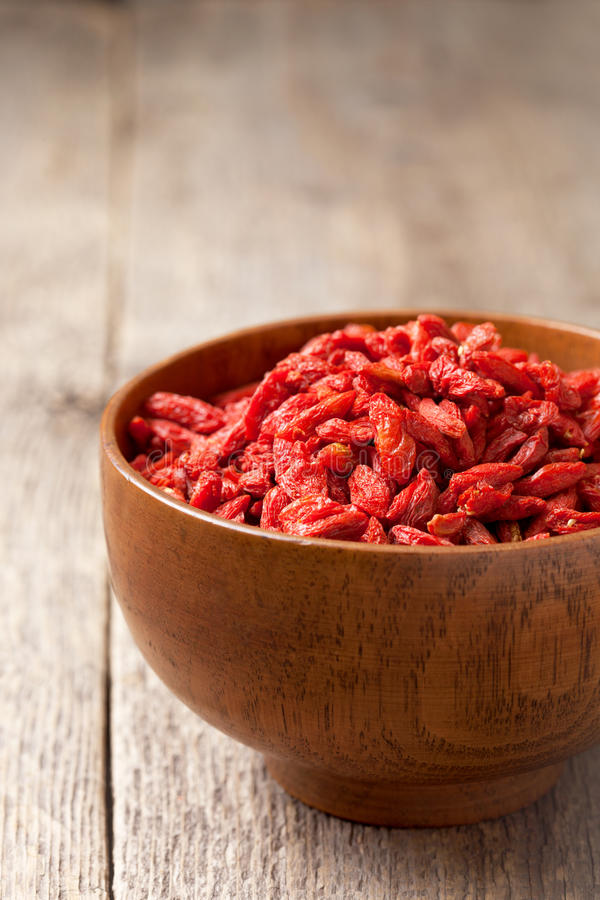 Download Goji Berries In A Wooden Bowl Stock Image - Image: 83703015