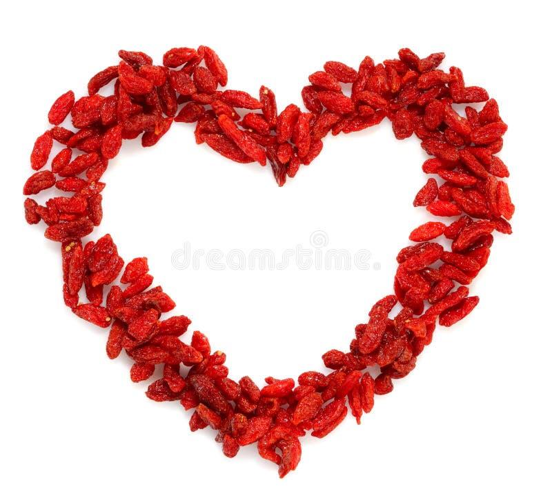 GOJI berryes de heldere rode kleur van de hartvorm royalty-vrije stock foto