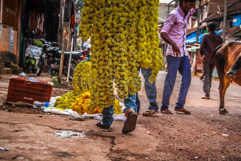 Colors of India. Gokarna Karnataka India November 01, 2017 Portrait of unknown people selling flowers in the street of Gokarna town, in the eveningn stock photos