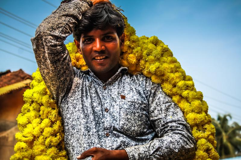 Colors of India. Gokarna Karnataka India November 01, 2017 Portrait of unknown people selling flowers in the street of Gokarna town, in the eveningn royalty free stock image
