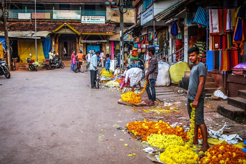 Colors of India. Gokarna Karnataka India November 01, 2017 Portrait of unknown people selling flowers in the street of Gokarna town, in the eveningn stock images