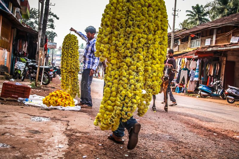 Colors of India. Gokarna Karnataka India November 01, 2017 Portrait of unknown people selling flowers in the street of Gokarna town, in the eveningn stock photo