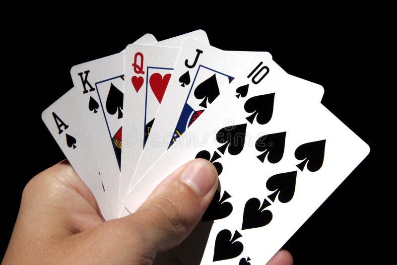 Gokkend In Hand Kaarten royalty-vrije stock afbeeldingen