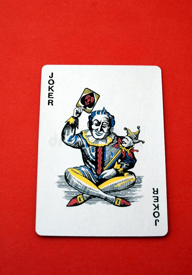 Gokkende kaart spel De speelkaart van de joker stock afbeeldingen