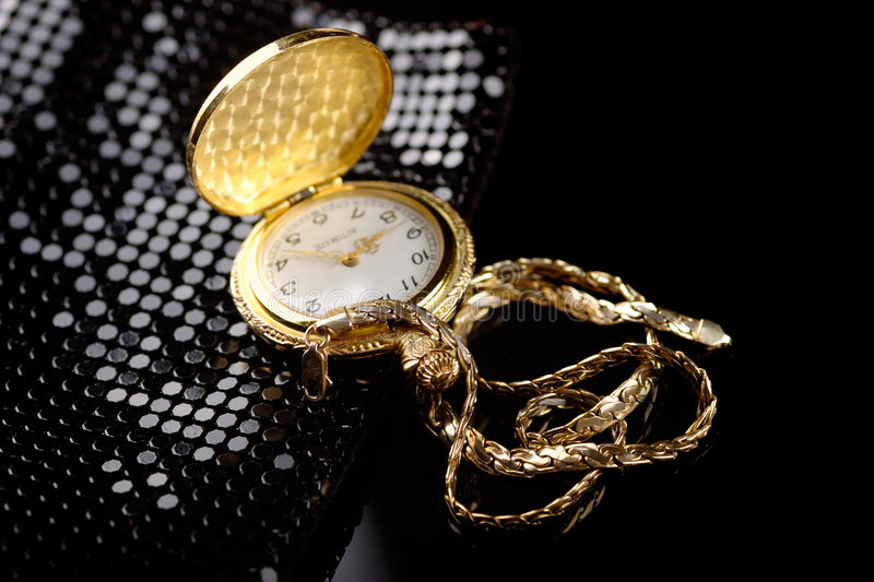 Gold. A golden chain and watch stock photography