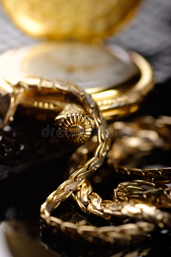 Gold. A golden chain and watch stock images
