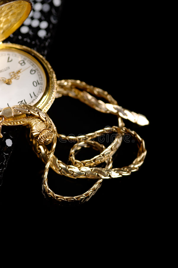 Gold. A golden chain and watch stock image