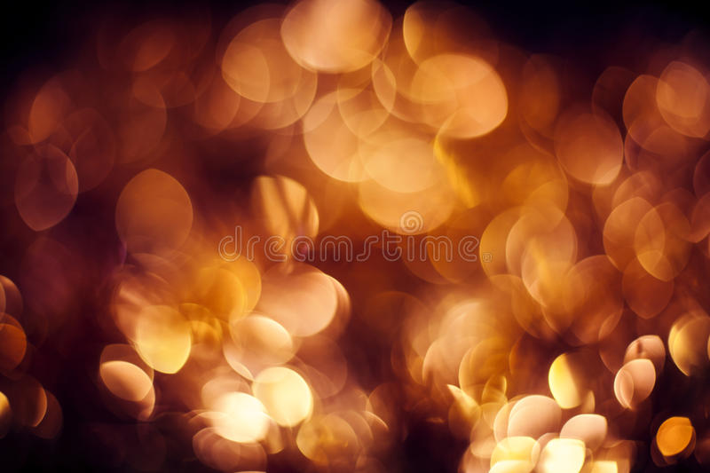 Gold abstract background. With bokeh defocused