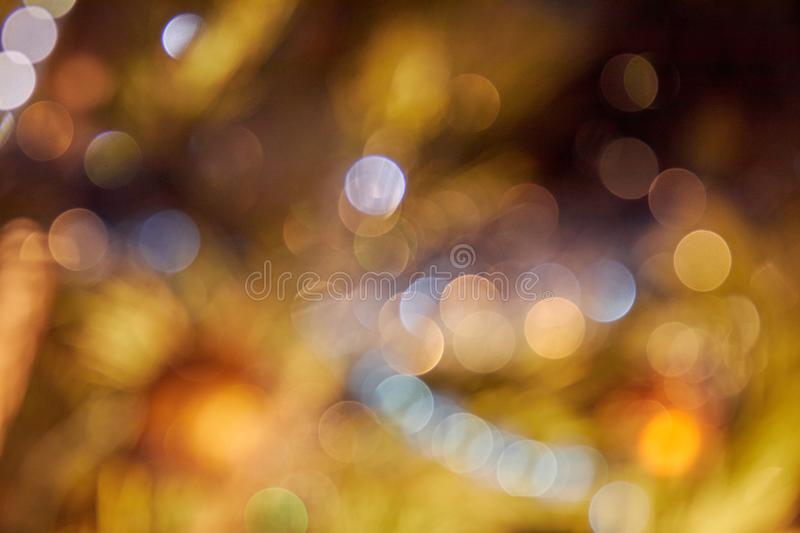 Gold abstract background with bokeh defocused lights stock photography