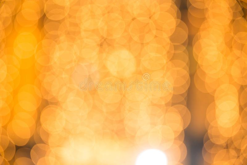 Gold abstract background with bokeh defocused lights. Copy space royalty free stock photo
